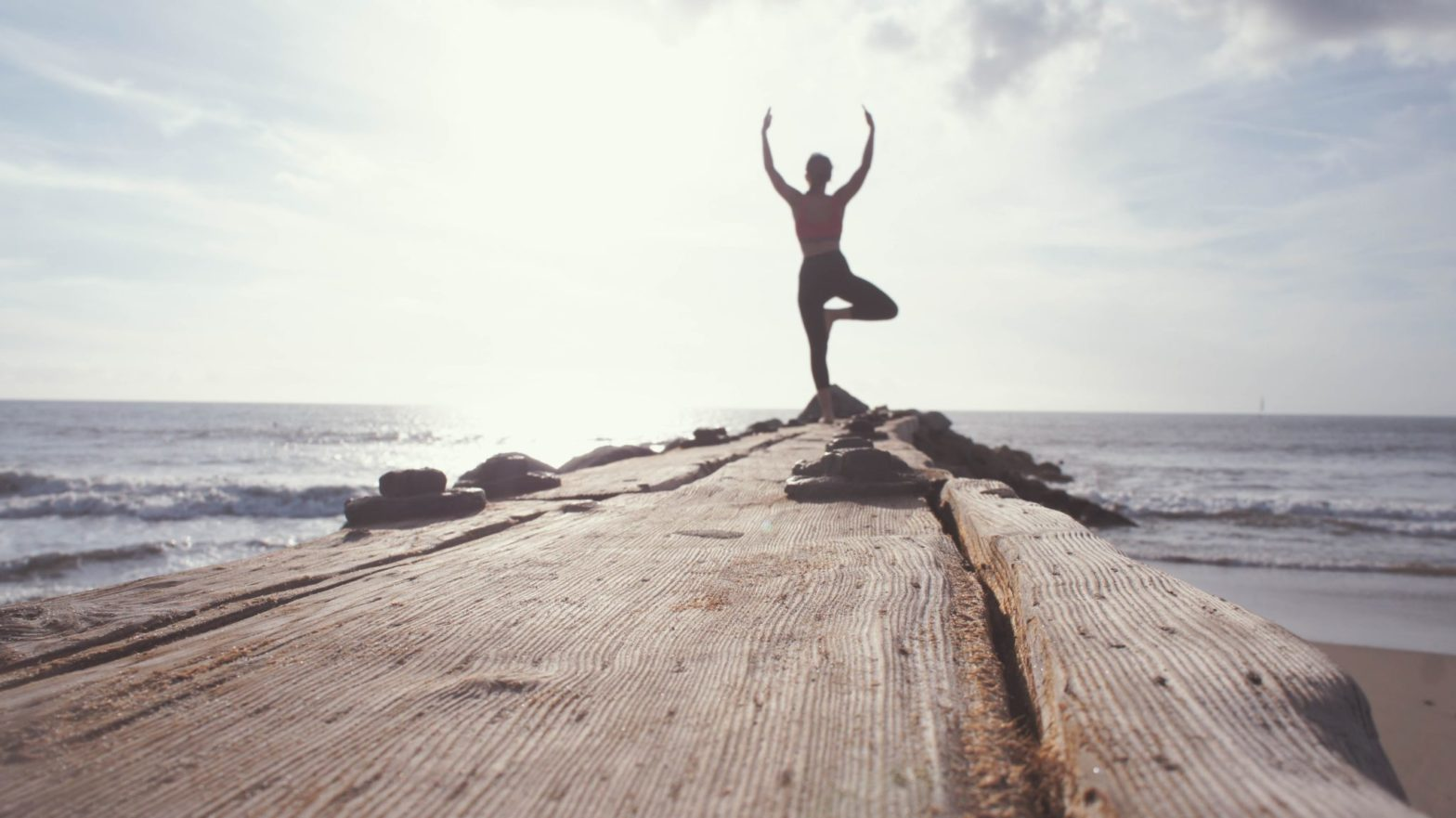 woman-standing-yoga-position-sea-infront-of-her