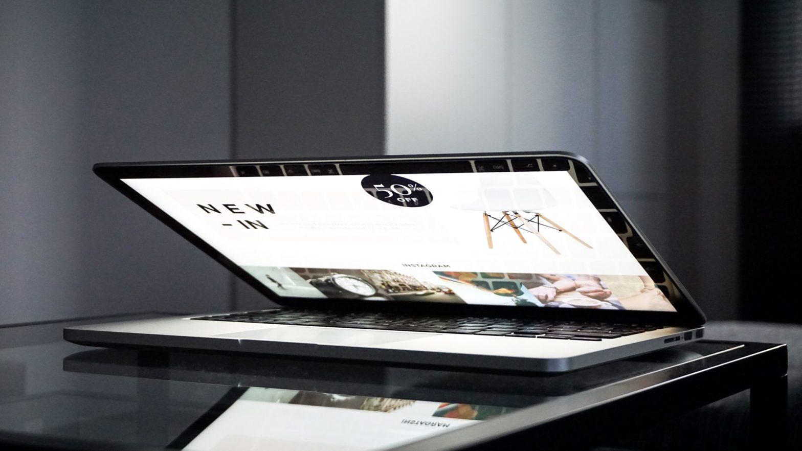 laptop-lid-half-closed-on-table