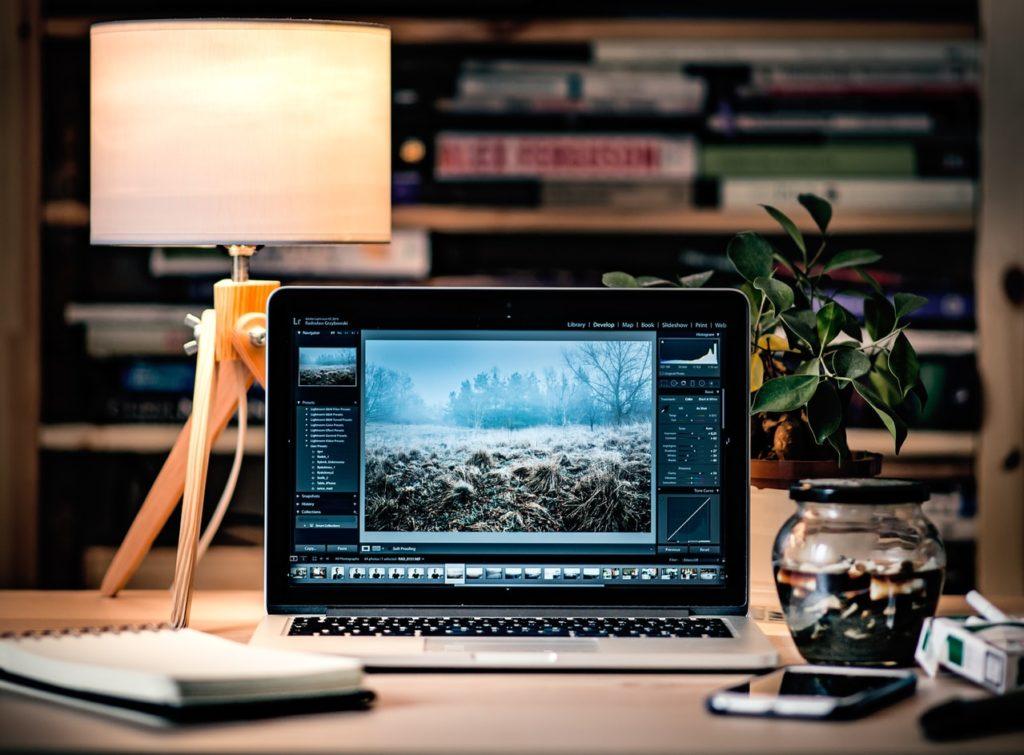 Image of a website open on a laptop on a desk