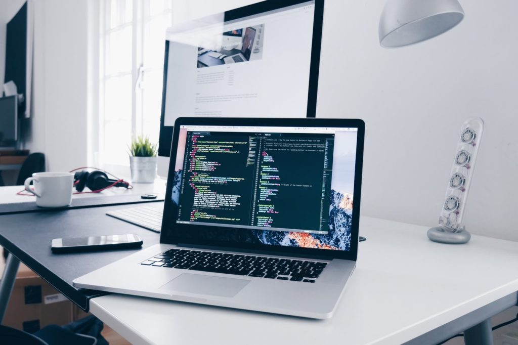 Coding on a website open on a laptop