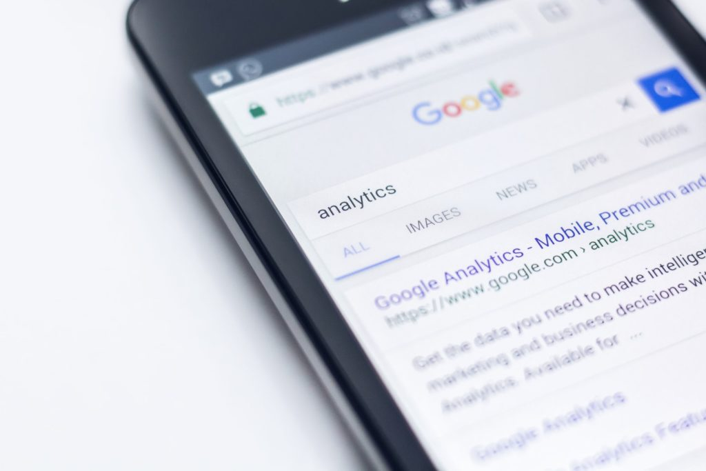 Smartphone with the Google Analytics homepage on the screen