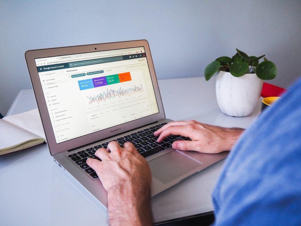Man on laptop with PPC campaign on screen