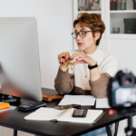 Woman sitting at her computer hosting a webinar