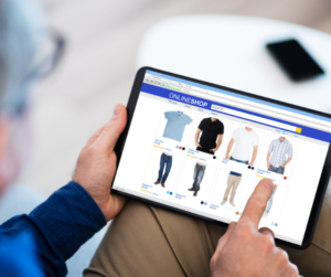Man on tablet shopping for clothing on a e-commerce store