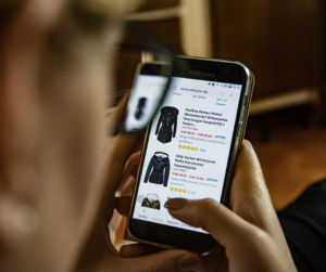 Woman on his smartphone looking at an e-commerce store