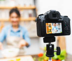 A video recording a woman doing a product demonstration ahead of reopening her business