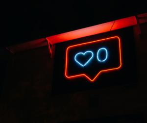 "A social media ""like"" in neon"