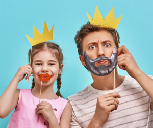 A Father and his daughter playing with photography props