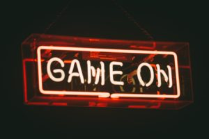 """""""game on"""" words in red neon"""