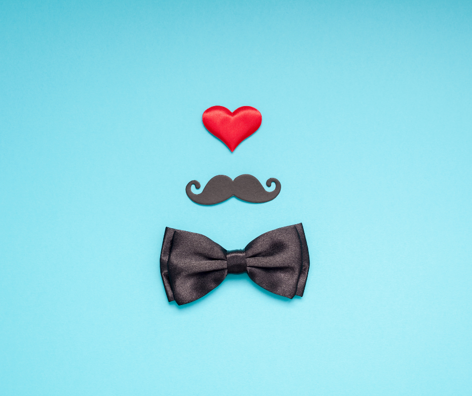 A heart, moustache and bow tie on a blue background representing a Father's Day campaign