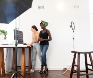 Two women standing in a DIY home studio