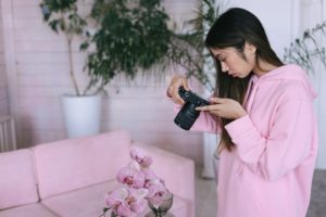A female photographer dressed in pic in her DIY home studio