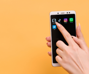 Woman pointing to social media apps on her smartphone