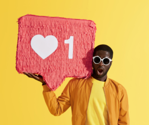 A man dressed in yellow holding a social media symbol used avoiding digital marketing mistakes
