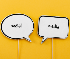 Two social media signs on a yellow background