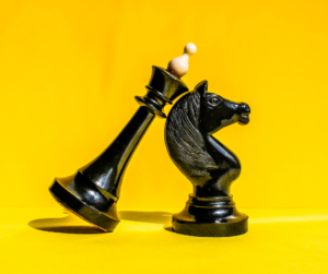 Chess pieces on a yellow background
