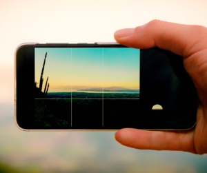 A person using the grid on their phone as a smartphone photography tip