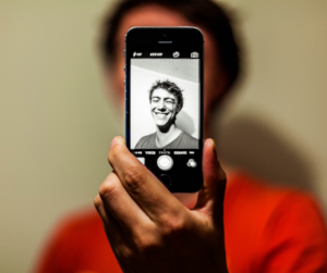 A man using portrait mode on his phone