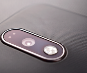 A smartphone flash and lens
