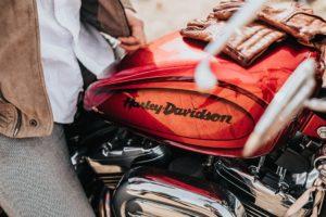 A man sitting on a Harley Davidson motorbike