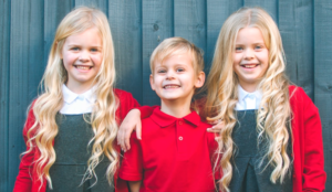 3 young children in school uniform promoting a back-to-school marketing campaign