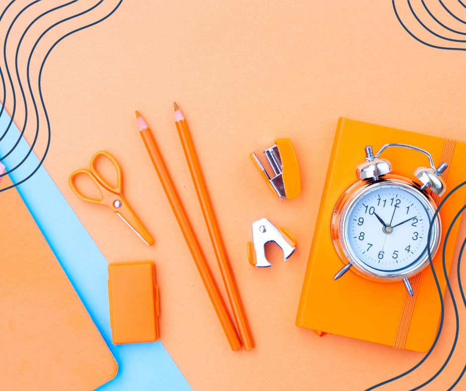 Orange school stationary on a orange background