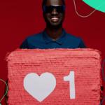 "A smiling man holding a social media ""like"" symbol"