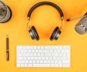 Podcast equipment on a yellow background