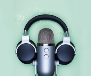 Headphones and a microphone on a green background