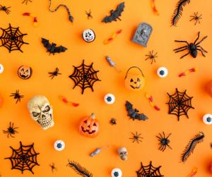 Halloween decor on an orange background