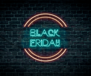 """A neon """"Black Friday"""" sign on a brick wall"""