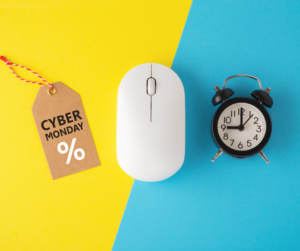 A Cyber Monday tag, a computer mouse and a clock on a yellow and blue background