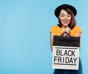 A woman holding a Black Friday shopping bag